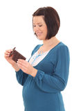 Pregnant and sweets Royalty Free Stock Photography