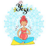 Pregnant tanned woman in lotus position against mandala backgrou Royalty Free Stock Photography