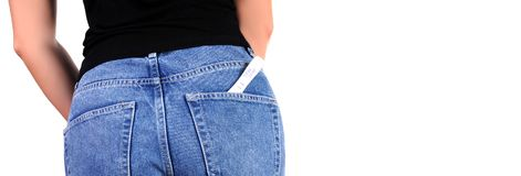 Woman with pregnancy test in pocket jeans. Pregnant test. Woman with pregnancy test in pocket jeans Royalty Free Stock Image