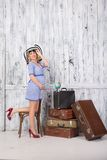 Pregnant tourist with suitcases Stock Photography