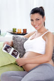 Pregnant with ultrasounds Stock Image