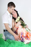 Pregnant wife and her husband sitting Stock Image