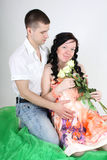 Pregnant wife and her husband sitting Stock Images