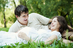 Pregnant wife and husband outdoors Stock Photos