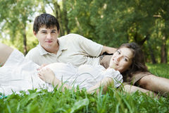 Pregnant wife and husband in park Stock Images