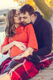 Pregnant wife and husband are resting near lake Royalty Free Stock Images