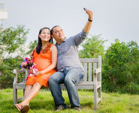 Pregnant Wife and Husband Taking Cell Phone Picture . Royalty Free Stock Photos