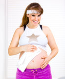 Pregnant wiping belly with towel after exercising Stock Images