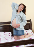 Pregnant woman. Nine month pregnant beautiful woman holding her belly Stock Image