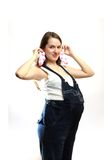 Pregnant woman. With baby's socks Royalty Free Stock Images