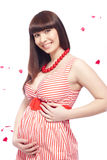Pregnant woman. In red dress stock image