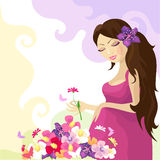 Pregnant woman. With colorful flowers Royalty Free Stock Photo