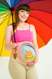 A pregnant woman. With body painting under an umbrella Royalty Free Stock Photos