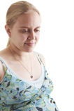 Pregnant woman. A pregnant young woman on a white background Royalty Free Stock Photography