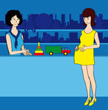 Pregnant woman. The pregnant woman in a toy shop talks to the seller, choosing toys Royalty Free Stock Image