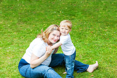 Pregnant woman and adorable little toddler son in Royalty Free Stock Photos