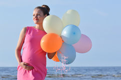 Pregnant woman with air balloons Royalty Free Stock Photos
