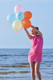 Pregnant woman with air balloons Royalty Free Stock Photo