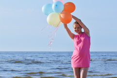 Pregnant woman with air balloons Royalty Free Stock Images