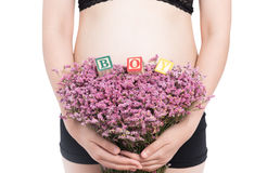 Pregnant woman and alphabet blocks spelling BOY on white backgro Stock Photos
