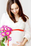 Pregnant Woman And Flower Royalty Free Stock Images