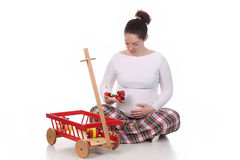 Pregnant Woman And Toys Stock Photos