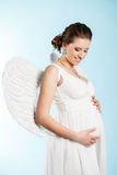 Pregnant woman with angel wings Stock Image