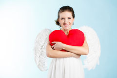 Pregnant woman with angel wings Stock Images