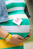 A pregnant woman. In anticipation of the birth of the child Stock Photography