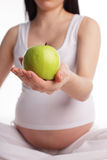 Pregnant woman with apple Royalty Free Stock Photo