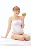 Pregnant woman with apple Royalty Free Stock Photos