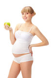 Pregnant woman with apple Royalty Free Stock Image