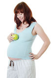 The pregnant woman with an apple Stock Photos