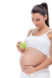 Pregnant woman with apple Royalty Free Stock Images