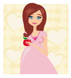 Pregnant woman with apple Stock Image
