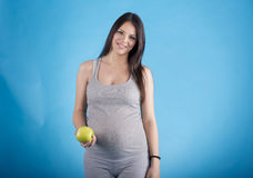 Pregnant woman with the apple Stock Photo