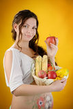 Pregnant woman with apple and wicker basket harvest. Stock Photography