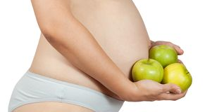 Pregnant woman with  apples Royalty Free Stock Photos