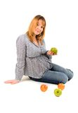 Pregnant woman with apples Royalty Free Stock Photo