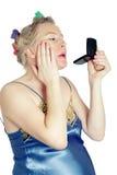Pregnant woman applying cosmetics Royalty Free Stock Image
