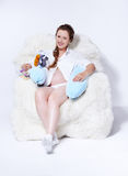 Pregnant woman in arm-chair Stock Photo