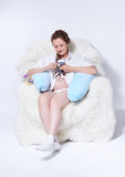 Pregnant woman in arm-chair Royalty Free Stock Photography