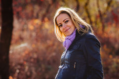 Pregnant woman in autumn forest Stock Photo
