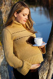 Pregnant woman on the autumn lake Royalty Free Stock Photography
