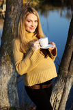 Pregnant woman on the autumn lake Stock Photography