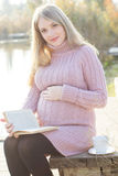 Pregnant woman on the autumn lake Royalty Free Stock Images