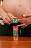 Pregnant woman and baby Stock Photo