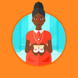 Pregnant woman with baby booties. An african-american young pregnant woman holding baby booties in hands. Smiling pregnant woman holding baby booties on the royalty free illustration