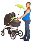 Pregnant woman with baby carriage Royalty Free Stock Photo