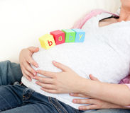 Pregnant woman with baby cubes on her belly Royalty Free Stock Images